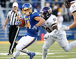 BROOKINGS, SD - SEPTEMBER 24:  Brady Mengarelli #44 from South Dakota State University sis brought down from behind by Khalen Saunders #99 from Western Illinois in the first half of their game Saturday evening at Dana J. Dykhouse Stadium in Brookings. (Photo by Dave Eggen/Inertia)