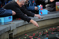 Pictured: Young cadets and women deposit poppies in the fountain Friday 11 November 2016<br />Re: Remembrance Day service at Castle Square Gardens in Swansea, south Wales, UK.