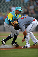 Catcher Carlos Sanchez (6) of the Columbia Fireflies is caught in a rundown by third baseman Max Burt (25) of the Charleston RiverDogs in a game on Friday, July 12, 2019 at Segra Park in Columbia, South Carolina. The RiverDogs won, 4-3, in 10 innings. (Tom Priddy/Four Seam Images)