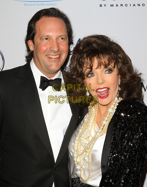 PERCY GIBSON & JOAN COLLINS .at the 32nd Annual Carousel Of Hope Ball held at The Beverly Hilton Hotel, Beverly Hills, CA, USA, .23rd October 2010..half length black sequined sequin jacket trousers white shirt pearl necklace tuxedo bow tie tux husband wife mouth open funny .CAP/ADM/KB.©Kevan Brooks/AdMedia/Capital Pictures.