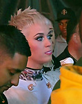 04.06.2017; Manchester, UK: KATY PERRY<br /> enjoys an ice-cream after her performance at the One Love Manchester concert at the Old Trafford in Manchester.<br /> The charity concert which she helped organise was held to help raise money for the We Love Manchester Emergency Fund, for the victims of the terror attack of May 22nd. <br /> Justin Bieber, Coldplay, Miley Cyrus, Katy Perry, Pharrell Williams, Black Eyed Peas, Usher, Take That and Robbie Williams were among those performing. <br /> Mandatory Credit Photo: &copy;NEWSPIX INTERNATIONAL<br /> <br /> Newspix International, 31 Chinnery Hill, Bishop's Stortford, ENGLAND CM23 3PS<br /> Tel:+441279 324672  ; Fax: +441279656877<br /> Mobile:  07775681153<br /> e-mail: info@newspixinternational.co.uk<br /> Please refer to usage terms. All Fees Payable To Newspix International