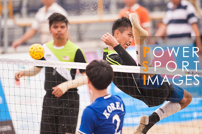 MOHD NORDIN Muhammad Noraizat M. N. of Malaysia plays a shot against Korea Republic the Beach Sepaktakraw Men's team competition on Day Eight of the 5th Asian Beach Games 2016 at My Khe Beach on 01 October 2016, in Danang, Vietnam. Photo by Marcio Machado / Power Sport Images
