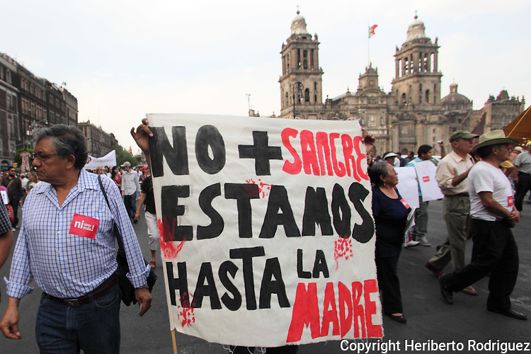Mexican citizens stage a protest against the violence in Mexico as they arrive at the Mexico City's main plaza Zocalo, April 6, 2011. More than 30 thousand people have died since Mexican President started a so called War against drugs after taking office in 2006. Photo by Heriberto Rodriguez
