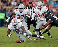 Ohio State Buckeyes defensive lineman Noah Spence (8) falls on a fumble during the first quarter of the NCAA football game at Ross-Ade Stadium in West Lafayette, Ind. on Nov. 2, 2013. (Adam Cairns / The Columbus Dispatch)