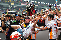 3rd November 2019; Sepang Circuit, Sepang Malaysia; MotoGP Malaysia, Race Day;  Second placed Marc Marquez lifts younger brother Alex who earlier become moto2 world champion after the race - Editorial Use