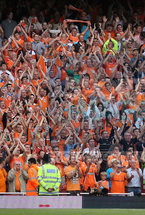 Blackpool's fans applaud their players at the final whistle