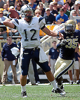 New Hampshire quarterback R.J. Toman gets pressured by Pitt defensive end Brandon Lindsey #35. The Pittsburgh Panthers defeat the New Hampshire Wildcats 38-16 at Heinz Field, Pittsburgh Pennsylvania on September 11, 2010.