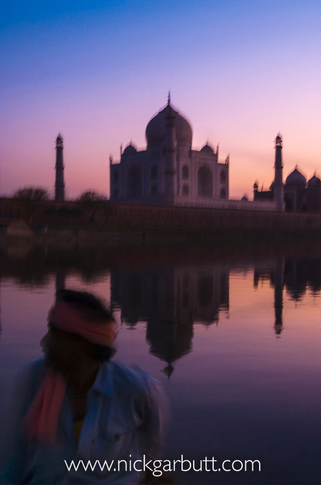 Taj Mahal at dusk. Taken from a boat on the Yamuna River. Agra, India.