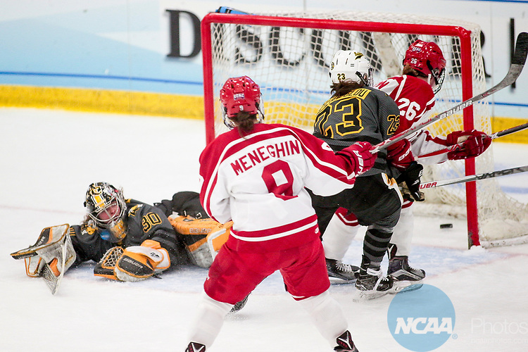 ADRIAN, MI - MARCH 18: Plattsburgh State forward Kayla Meneghin (9) and forward Melissa Sheeran (26) watch the puck go in the net during the Division III Women's Ice Hockey Championship held at Arrington Ice Arena on March 19, 2017 in Adrian, Michigan. Plattsburgh State defeated Adrian 4-3 in overtime to repeat as national champions for the fourth consecutive year. by Tony Ding/NCAA Photos via Getty Images)