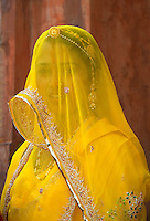 a well dressed women in Bikaner is a District in the northwest of the state of Rajasthan in northern India. The city is the administrative headquarters of Bikaner District and Bikaner division. It was formerly the capital of the princely state of Bikaner. The city was founded by Rao Bika in 1486 and from its small origins it has developed into the fourth largest city in Rajasthan. Just like Jaipur, Bikaner is called the Green City. .Bikaner Fort is popularly referred to as the Junagarh Fort. It was built by Raja Rai Singh who was one of Mughal emperor Akbar's trusted generals. There are as many as 37 citadels which protects the fort. This is one fort in Rajasthan which has never been annexed or conquered. There was one dubious instance though when Prince Kamaran laid seize to the fort, but could not keep it on hold for even 24 hours..