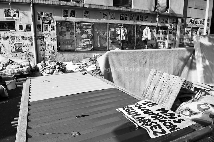 After 18 months of occupation, the last occupants of the Bourse du Travail still camping in the street were expulsed by the police on September 23, 2009, leaving behind mattresses, blankets, clothes and some personal belongings. A couple of hours later, all of these were thrown away by the municipal cleaning services.