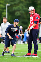 July 27, 2017:  New England Patriots quarterback Tom Brady (12) puts on gloves at the New England Patriots training camp held on the practice field at Gillette Stadium, in Foxborough, Massachusetts. Eric Canha/CSM
