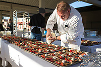 NWA Democrat-Gazette/CHARLIE KAIJO Chef Miles James of MJ Pizzeria in Springdale pipes a apple cakes topped with blueberries, strawberries and cream, Saturday, June 9, 2018 on Emma Ave. in Springdale. <br /><br />Back for its 3rd year, this popular event brought hundreds of guests together for a lively, friendly community dinner of multiple courses served under the night sky&acirc;&euro;&rdquo;right down the middle of Emma Avenue. Past attendees raved about the special experience of dining al fresco with family and friends, as well as meeting new neighbors.