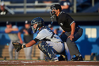 Staten Island Yankees catcher Eduardo Navas (58) and umpire Jhonatan Biarreta await the pitch during a game against the Batavia Muckdogs on August 26, 2016 at Dwyer Stadium in Batavia, New York.  Staten Island defeated Batavia 6-2.  (Mike Janes/Four Seam Images)