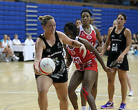 20.1.2014 New Zealand's Catherine Latu competes for ball with England's Ama Agbeze during their netball test match in London, England. Mandatory Photo Credit (Pic: David Klein). ©Michael Bradley Photography.