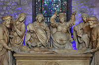 The Entombment, c. 1530, sculptural group, in the Basilique Saint Remi or Abbey of St Remi, Reims, France. Behind is a stained glass window made from fragments of the original 12th century choir windows destroyed in World War One. The 11th century, mainly Romanesque, church, contains the relics of St Remi, the Bishop of Reims, who converted Clovis, the King of the Franks, to Christianity in 496 AD. The abbey is a UNESCO World Heritage Site. Picture by Manuel Cohen