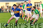 St. Senans Cathal Kennelly gets away from  Ballydonoghue's Stephen Lonergan  in the Final of the Bernard O Callaghan North Kerry Senior Football Championship, sponsored by McMunns Bar and Restaurant Ballybunion, St.Senans V Ballydonoghue  at Frank Sheehy Park, Listowel on Sunday