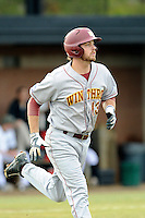 Second baseman Chad Smith (13) of the Winthrop University Eagles runs toward first in a game against the University of South Carolina Upstate Spartans on Wednesday, March 4, 2015, at Cleveland S. Harley Park in Spartanburg, South Carolina. Upstate won, 12-3. (Tom Priddy/Four Seam Images)