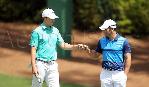 April 7, 2016 - Augusta, Georgia, U.S. - JORDAN SPIETH, L, and PAUL CASEY fist bump after they both birdie the tenth hole during the first round of the Masters Golf Tournament at Augusta National Golf Club