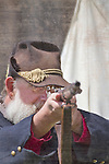 A union soldier points a cap and ball muzzle loaded rifle  during a Civil War reenactment.