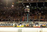 Nov. 13, 2009; Avondale, AZ, USA; NASCAR Camping World Truck Series driver Kevin Harvick (4) takes the checkered flag ahead of Kyle Busch during the Lucas Oil 150 at Phoenix International Raceway. Mandatory Credit: Mark J. Rebilas-