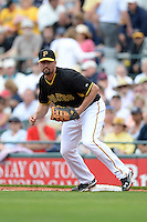First baseman Gaby Sanchez (17) of the Pittsburgh Pirates during a spring training game against the New York Yankees on February 26, 2014 at McKechnie Field in Bradenton, Florida.  Pittsburgh defeated New York 6-5.  (Mike Janes/Four Seam Images)