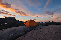 Tent pitched on rocky terrain near summit of Moldtind mountain peak, Moskenesøy, Lofoten Islands, Norway