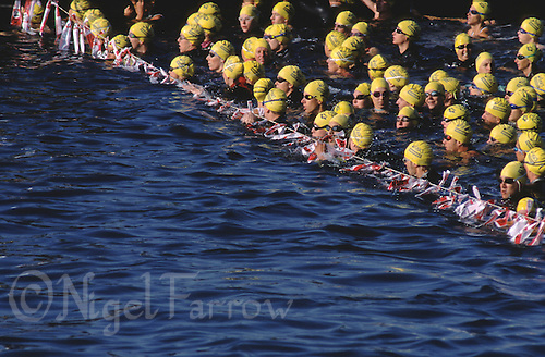 AUG 1998 - LAUSANNE, SWITZERLAND - Age group competitors wait for their wave start at the  World Triathlon Championships. (PHOTO (C) NIGEL FARROW)