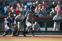 Salt River Rafters shortstop Jazz Chisholm (1), of the Arizona Diamondbacks organization, follows through on his swing in front of catcher Joe DeCarlo (4) during the Arizona Fall League Championship Game against the Peoria Javelinas at Scottsdale Stadium on November 17, 2018 in Scottsdale, Arizona. Peoria defeated Salt River 3-2 in 10 innings. (Zachary Lucy/Four Seam Images)