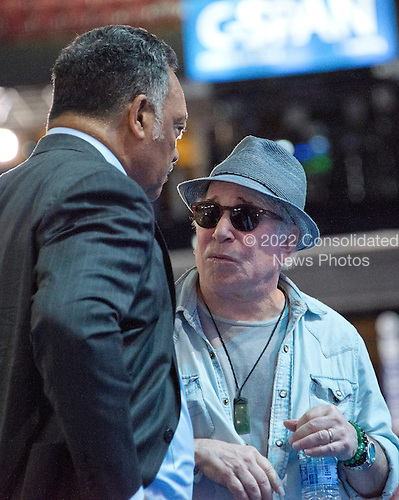 Singer and songwriter Paul Simon and the Reverend Jesse Jackson, Sr. prior to the start of the 2016 Democratic National Convention held at the Wells Fargo Center in Philadelphia, Pennsylvania on Sunday, July 24, 2016.<br /> Credit: Ron Sachs / CNP<br /> (RESTRICTION: NO New York or New Jersey Newspapers or newspapers within a 75 mile radius of New York City)