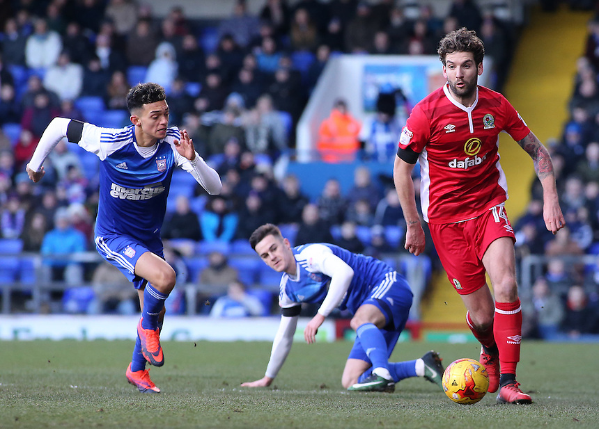 Blackburn Rovers' Charlie Mulgrew gets away from Ipswich Town's Tom Lawrence &amp; Andre Dozzell<br /> <br /> Photographer David Shipman/CameraSport<br /> <br /> The EFL Sky Bet Championship - Ipswich Town v Blackburn Rovers - Saturday 14th January 2017 - Portman Road - Ipswich<br /> <br /> World Copyright &copy; 2017 CameraSport. All rights reserved. 43 Linden Ave. Countesthorpe. Leicester. England. LE8 5PG - Tel: +44 (0) 116 277 4147 - admin@camerasport.com - www.camerasport.com