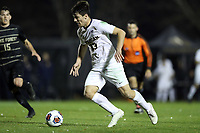 WINSTON-SALEM, NC - DECEMBER 01: Nebojsa Popovic #33 of the University of Michigan plays the ball during a game between Michigan and Wake Forest at W. Dennie Spry Stadium on December 01, 2019 in Winston-Salem, North Carolina.