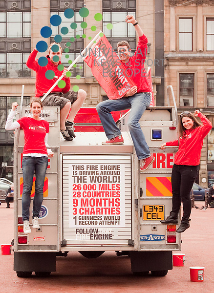 L-r  , Amy Harpin (31) Wakefeild, Garth Moore (32)  ,.James Morrow (32). Gemma Rowland (28).   Follow that Fire Engine'.in which a group of friends try to circumnavigate the globe in a fire.engine. The tour is is in memory of crew member Steve Moore's father Garth.who died of lung cancer in 2009 and the group are raising funds for.Macmillan Cancer Support, The Fire Fighters Charity and The Roy Castle Lung.Cancer Foundation Picture Credit / Johnny Mclauchlan/Universal News and Sport, Scotland. 20/05/10.