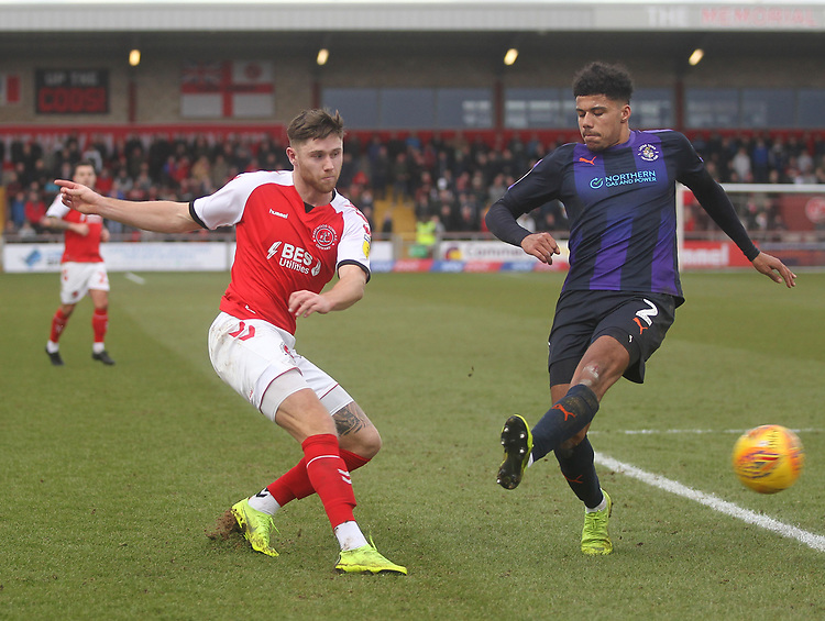 Fleetwood Town's Wes Burns  gets a shot past Luton Town's James Justin <br /> <br /> Photographer Mick Walker/CameraSport<br /> <br /> The EFL Sky Bet League One - Fleetwood Town v Luton Town - Saturday 16th February 2019 - Highbury Stadium - Fleetwood<br /> <br /> World Copyright © 2019 CameraSport. All rights reserved. 43 Linden Ave. Countesthorpe. Leicester. England. LE8 5PG - Tel: +44 (0) 116 277 4147 - admin@camerasport.com - www.camerasport.com