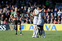 Manusamoa Tuilagi of Leicester Tigers celebrates with team mates as Joe Marler of Harlequins (left) looks on during the Aviva Premiership match between Harlequins and Leicester Tigers at The Twickenham Stoop on Saturday 21st April 2012 (Photo by Rob Munro)