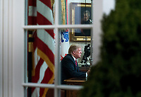 President Donald Trump is seen through the window of the Oval Office as he delivers a primetime address on the government shutdown and his funding request for over $5 billion for a southern border wall, at the White House in Washington, D.C. <br /> CAP/MPI/RS<br /> &copy;RS/MPI/Capital Pictures