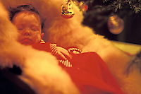3 month old baby sleeping under a Christmas tree