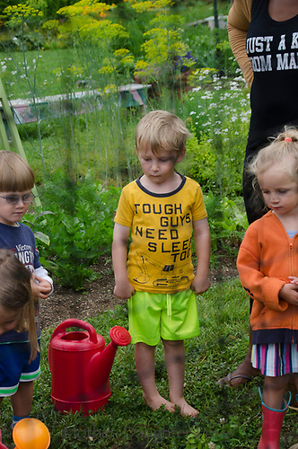 "Young boy in garden camp with great T-shirt ""tough guys need sleep too"", Yarmouth Community Garden, Maine, USA"