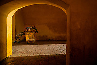 A Colombian stret vendor pushes his cart through the Clock Tower gate, the entrance to the colonial walled city, during the sunrise in Cartagena, Colombia, 13 December 2017. With the peace agreement, ending a 52-year civil conflict and promising political stability, together with rapid economic growth and unexploited tourism potential, Colombia has truly become a holiday destination. Cartagena, a UNESCO World Heritage site on the tropical Caribbean coast, plays the primary role in Colombia's tourism renaissance. The historic sites from the Spanish colonial times are being restored, private investments are visible throughout the city and an increased number of local people benefit from the boom of the travel related services.