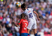 PARIS,  - JUNE 16: Carla Guerrero #3 has the ball headed over her by Carli Lloyd #10 during a game between Chile and USWNT at Parc des Princes on June 16, 2019 in Paris, France.