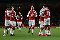 Jack Wilshere of Arsenal (2nd right) celebrates after he scores his team's third goal of the game to make the score 3-0 during the UEFA Europa League match between Arsenal and FC BATE Borisov  at the Emirates Stadium, London, England on 7 December 2017. Photo by David Horn.