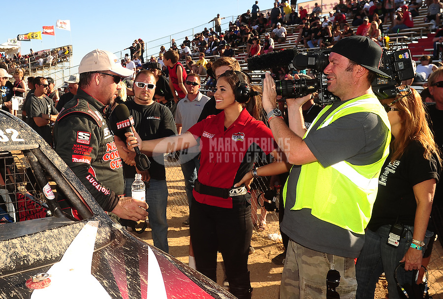 Apr 17, 2011; Surprise, AZ USA; LOORRS driver Chris Brandt (left) is interviewed by Keli Snyder following round 4 at Speedworld Off Road Park. Mandatory Credit: Mark J. Rebilas-