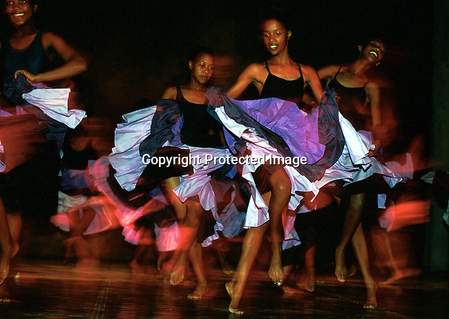 Dance students in the Dance for All program on November 25, 2000, dancing at a yearly performance in Guguletu, South Africa. Highly talented, these children dance ballet, African, jazz, etc. The program was started by the Cape Town City ballet in the poor and destitute squatter camps nine years ago. About 200 kids aged from 6-18 are dancing 3 times a week and finding something meaningful to do after school. .Photo: Per-Anders Pettersson/Agentur Focus