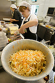 Catering staff making fresh salads, Barking Abbey School, London