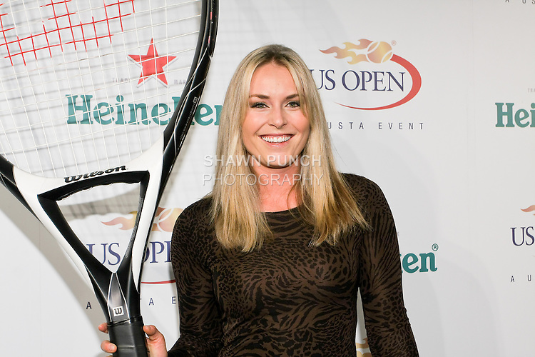 Lindsey Von hold hugh tennis racket at the US Open Player Party at The Empire Hotel, August 27, 2010.