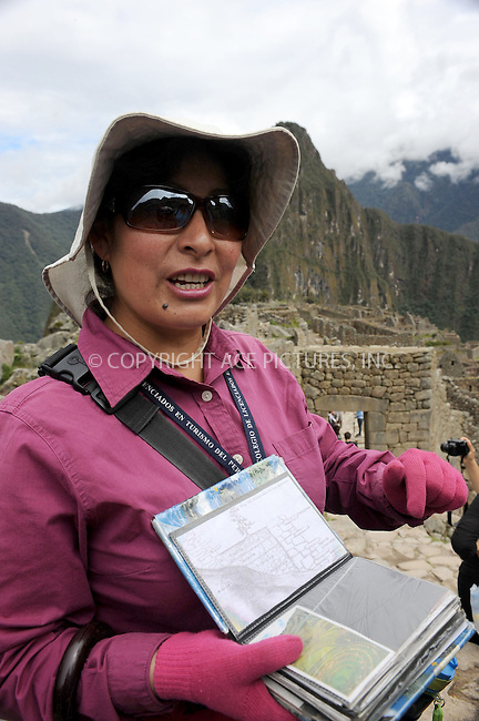 """WWW.ACEPIXS.COM . . . . . .January 8, 2013...Peru...Huayna Picchu also known as Wayna Picchu (Quechua: """"Young Peak"""") is a mountain in Peru around which the Urubamba River bends. It rises over Machu Picchu, the so-called lost city of the Incas, and divides it into sections. The Incas built a trail up the side of the Huayna Picchu and built temples and terraces on its top. The peak of Huayna Picchu is about 2,720 metres (8,920 ft) above sea level, or about 360 metres (1,180 ft) higher than Machu Picchu on January 8, 2013 in Peru ....Please byline: KRISTIN CALLAHAN - ACEPIXS.COM.. . . . . . ..Ace Pictures, Inc: ..tel: (212) 243 8787 or 212 489 0521..e-mail: kristincallahan@aol.com...web: http://www.acepixs.com ."""