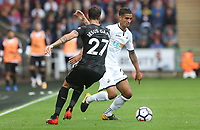Kyle Naughton of Swansea City is challenged by Jesus Gamez of Newcastle United during the Premier League match between Swansea City and Newcastle United at The Liberty Stadium, Swansea, Wales, UK. Sunday 10 September 2017