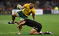 Tolu Latu of the Wallabies is tackled by Anton Lienert-Brown of the All Blacks during the Rugby Championship match between Australia and New Zealand at Optus Stadium in Perth, Australia on August 10, 2019 . Photo: Gary Day / Frozen In Motion