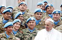 Papa Francesco posa con un gruppo di Caschi Blu dell'Onu al termine dell'udienza generale del mercoledi' in Piazza San Pietro, Citta' del Vaticano, 3 febbraio 2016.<br /> Pope Francis poses with a group of UN's Blue Berets peacekeeping soldiers at the end of his weekly general audience in St. Peter's Square at the Vatican, 3 February 2016.<br /> UPDATE IMAGES PRESS/Riccardo De Luca<br /> <br /> STRICTLY ONLY FOR EDITORIAL USE