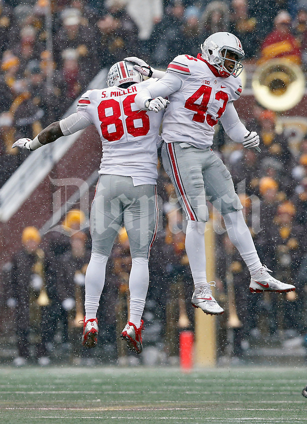 Ohio State Buckeyes linebacker Darron Lee (43) and Ohio State Buckeyes defensive lineman Steve Miller (88) celebrates after Lee made a tackle against  Minnesota Golden Gophers during the 3rd quarter at TCF Bank Stadium in Minneapolis, Minn. on November 15, 2014.  (Dispatch photo by Kyle Robertson)